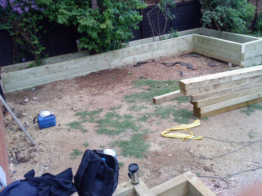 Complete landscaped project with sleeper beds, patio, turf and steps by Indigo Landscapers in Northampton