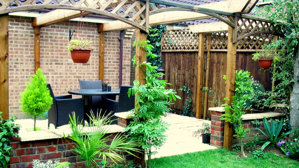 Patio, wall and pergola, Northampton by Indigo Landscapers